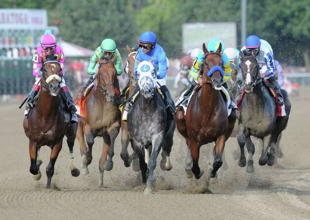 American Pharoah and Victor Espinoza, second from right, take an early lead into the Clubhouse turn during the Travers Stakes at Saratoga Race Course  Saturday afternoon, Aug. 29, 2015, in Saratoga Springs, N.Y. Keen Ice with Javier Castellano, second from left, was the winner. (Will Waldron/Times Union) Photo: WW / 00033155B
