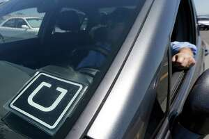 Calif. Uber drivers get class-action status in employment suit - Photo