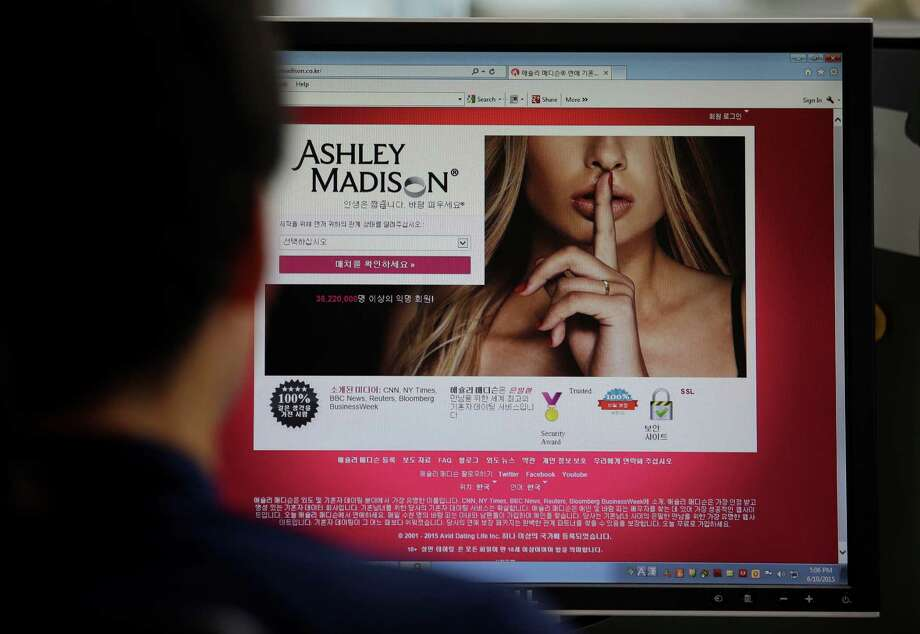 This file photo shows Ashley Madison's Korean web site on a computer screen in Seoul, South Korea. Ashley Madison — with its trademark manicured finger covering a foxy mouth — has been denounced, defended and, most grievously, taken seriously. Photo: Lee Jin-man /Associated Press / AP