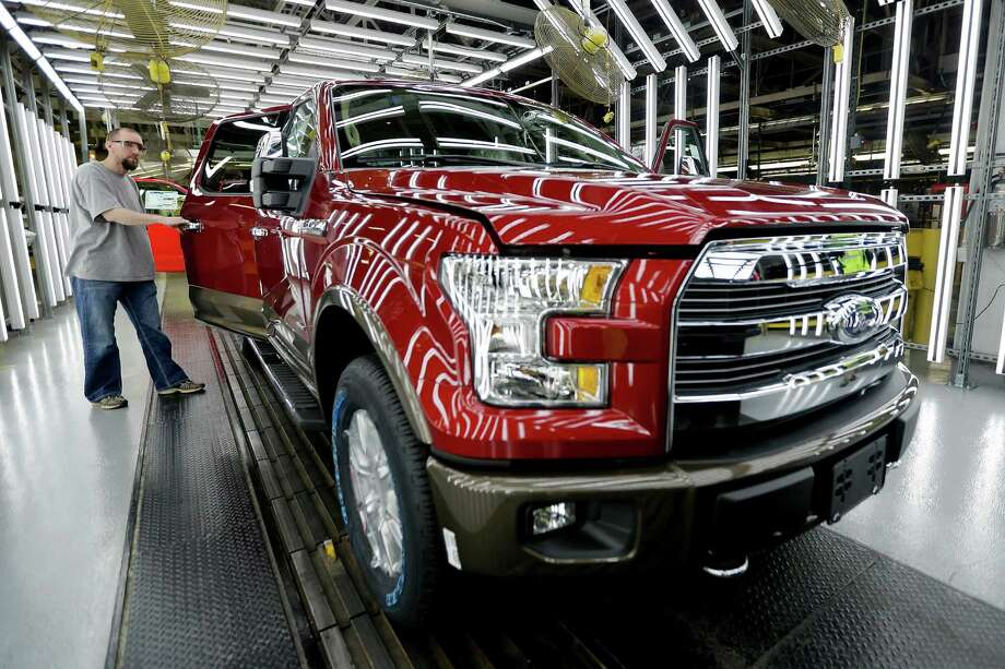 FILE - In this March 13, 2015 file photo, a worker inspects a new 2015 aluminum-alloy body Ford F-150 truck at the company's Kansas City Assembly Plant in Claycomo, Mo. Ford's U.S. sales jumped 5 percent in August 2015 as sales of its new F-150 pickup gained steam. (AP Photo/Charlie Riedel, File) ORG XMIT: NYBZ115 Photo: Charlie Riedel / AP