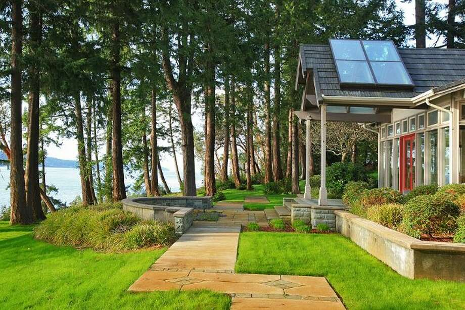 You could call this Whidbey Island home a getaway, but it is more than that. Its 23 acres include not only this 5,700-square-foot manor home but also many other features both inside and out. The full listing is here.  Photo: Linda Casale/Windermere