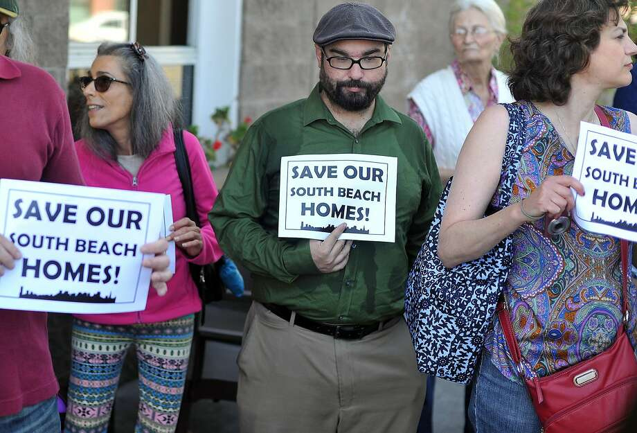 Local residents participates in a rally calling for changes to stop an out-of-state landlord from raising rents at the South Beach Marina Apartments in San Francisco on Sept. 1, 2015. Photo: Josh Edelson, JOSH EDELSON / SAN FRANCISCO CHR