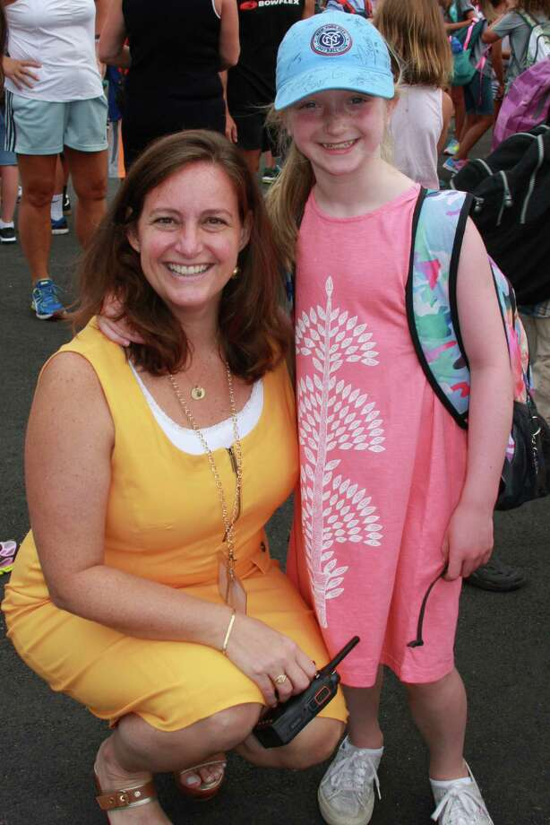 Holmes School Principal Paula Bleakley welcomes Jamison Maher back to school on Monday, Aug. 31. Photo: Contributed / Contributed Photo / Darien News
