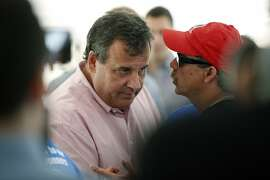 Republican presidential candidate, New Jersey Gov. Chris Christie  campaigns during a stop at a Greek festival in Manchester, N.H., Saturday, Aug. 29, 2015. (AP Photo/Michael Dwyer)