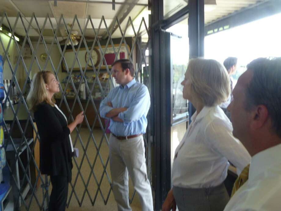 First Selectman Jayme Stevenson, left, talks to U.S. Sen. Christopher Murphy-D-Conn on Tuesday, Sept. 1 during a tour of the Noroton Heights Railroad Station to discuss prospective development. In the foreground are State Rep. Terrie Wood-R-Darien and State Sen. Bob Duff-D-Norwalk. Photo: Martin Cassidy / Hearst Connecticut Media / Darien News