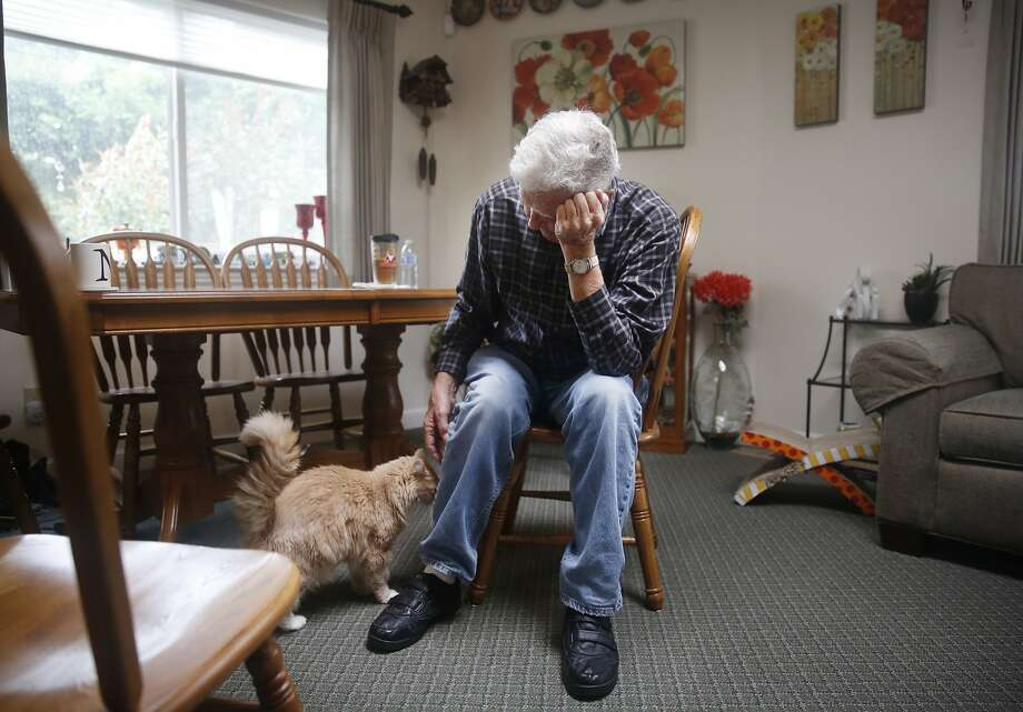 Bob Hensel pets his cat Dusty in the new home that was rebuilt after the San Bruno gas pipeline explosion. Dusty was found in a lot across the street from where Hensel's original house stood. Photo: Lea Suzuki, The Chronicle