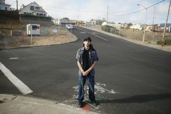 Joe Ruigomez stands at the intersection of Earl Avenue and Glenview Drive at the site of the San Bruno gas pipeline explosion on Thursday, July 23, 2015 in San Bruno, Calif.  Joe Ruigomez, who was the closest to the explosion,  nearly died in the San Bruno gas pipeline explosion.