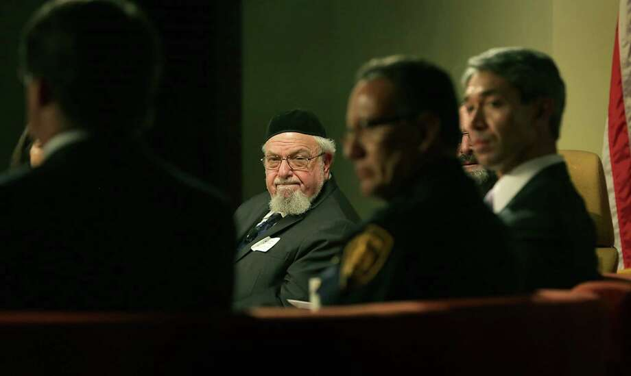 Rabbi Aryeh Scheinberg, center, listens to a panelist including Councilman Ron Nirenberg, right, at a Community Conversation-Preventing Hate Crimes hosted by the San Antonio Hispanic Chamber of Commerce at The Pearl Stable on Tuesday, Sept. 1, 2015. Photo: BOB OWEN / San Antonio Express-News / San Antonio Express-News