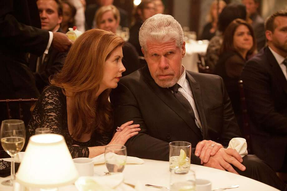 "This image provided by Amazon Studios shows Dana Delany, left, and Ron Perlman in a sceen from ""Hand of God."" The gutsy drama, which centers on ""Sons of Anarchy"" and ""Hellboy"" star Ron Perlman as a judge who believes God is guiding him after his family is attacked, is among the latest batch of potential series that'll be streamed online beginning Aug. 28 by Amazon. (AP Photo/Amazon Studios, Karen Ballard) Photo: Karen Ballard, Associated Press"