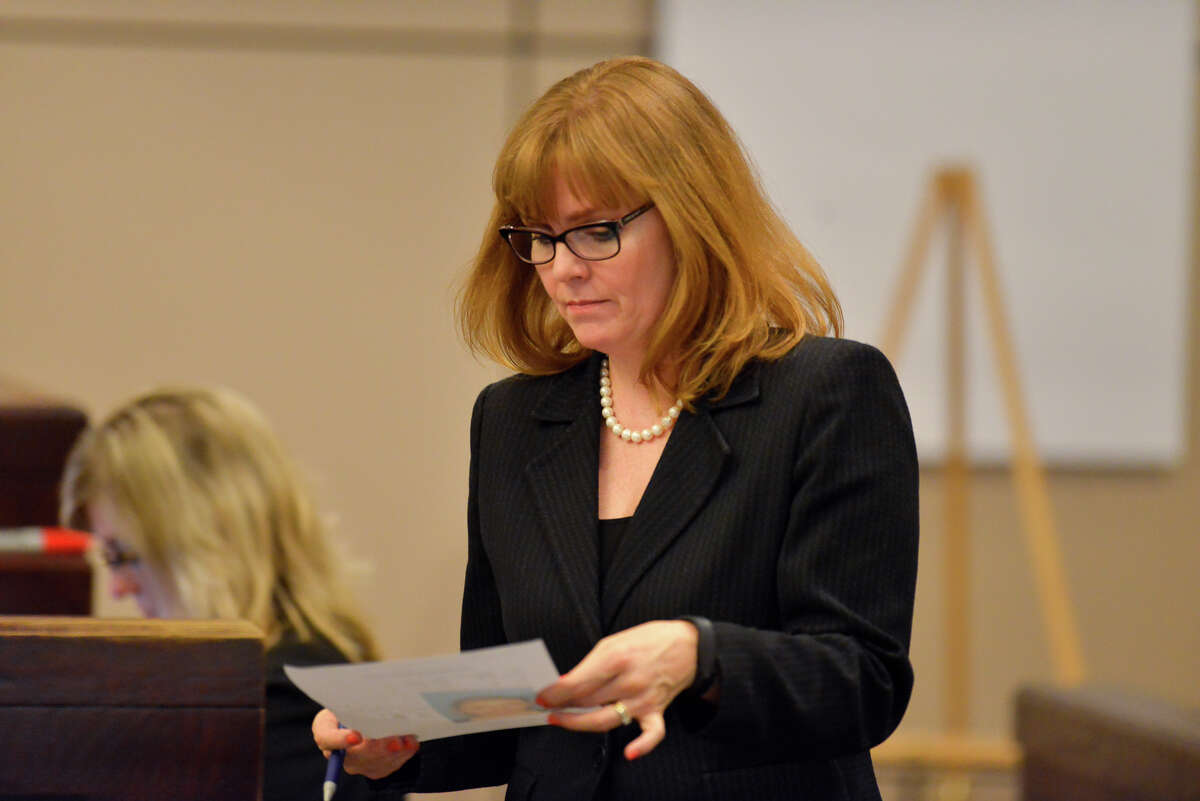 Prosecutor Catherine Hayes looks over information during the opening of the capital murder trial of Devin Fields. Fields is accussed of capital murder in the shooting death of Baby Girl Mshae Harrison.