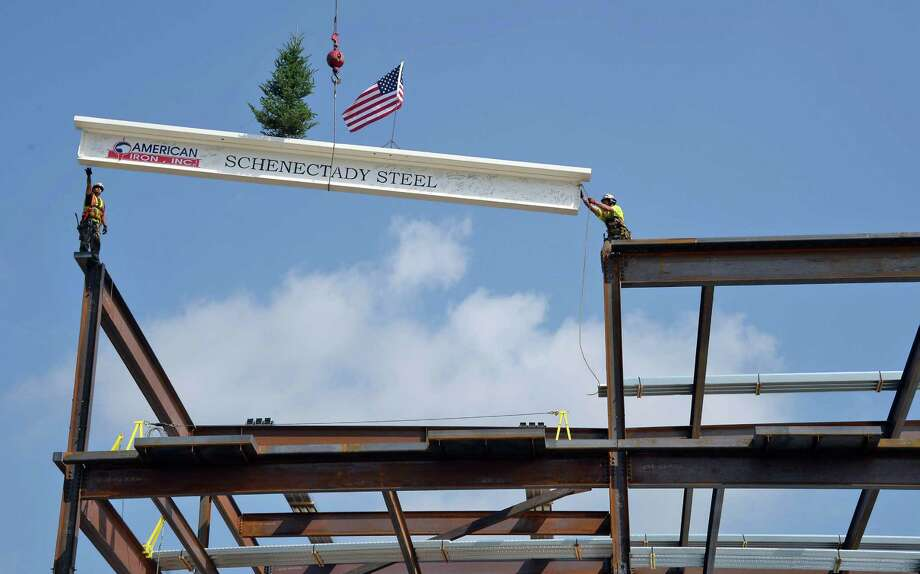 Iron workers place the last beam as Saratoga Casino and Raceway holds a topping out ceremony in recognition of their hotel expansion project reaching its peak height Tuesday Sept. 1, 2015 in Saratoga Springs, NY.   (John Carl D'Annibale / Times Union) Photo: John Carl D'Annibale / 00033192A