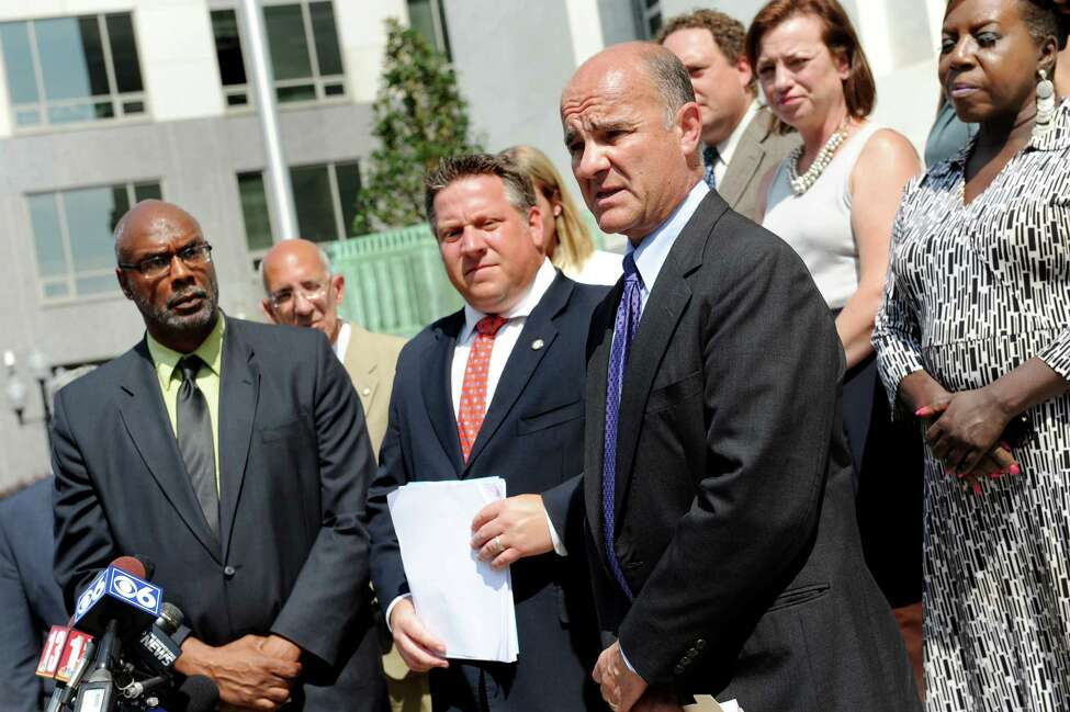 Chris Amato, an attorney with Earth Justice, third from right, announces an intent to sue Global Partners over federal air pollution rules on Tuesday, Sept. 1, 2015, at the Federal Court House in Albany , N.Y. Joining him are Aaron Mair, president of Sierra Club, left, and Albany County Executive Dan McCoy, center. (Cindy Schultz / Times Union)