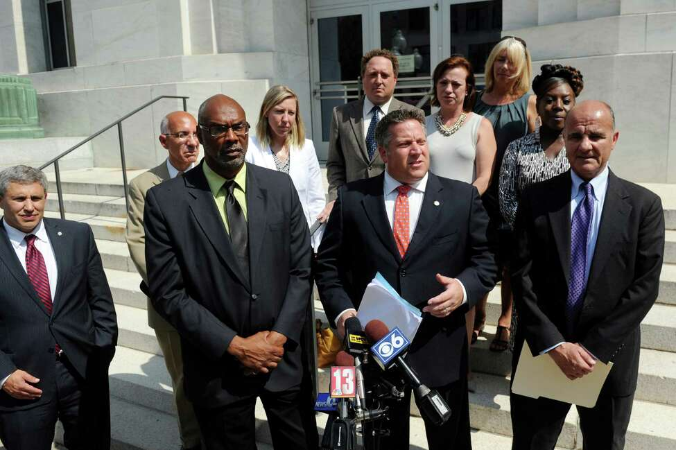 Albany County Executive Dan McCoy, center, announces an intent to sue Global Partners over federal air pollution rules on Tuesday, Sept. 1, 2015, at the Federal Court House in Albany , N.Y. (Cindy Schultz / Times Union)