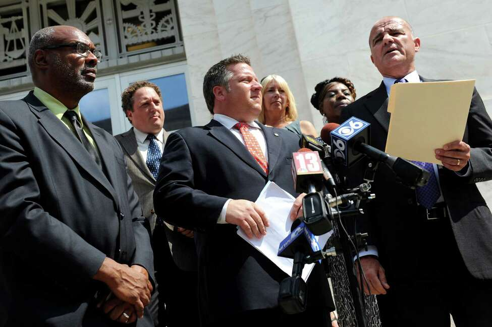 Chris Amato, an attorney with Earth Justice, right, announces an intent to sue Global Partners over federal air pollution rules on Tuesday, Sept. 1, 2015, at the Federal Court House in Albany , N.Y. Joining him are Aaron Mair, president of Sierra Club, left, and Albany County Executive Dan McCoy, center. (Cindy Schultz / Times Union)