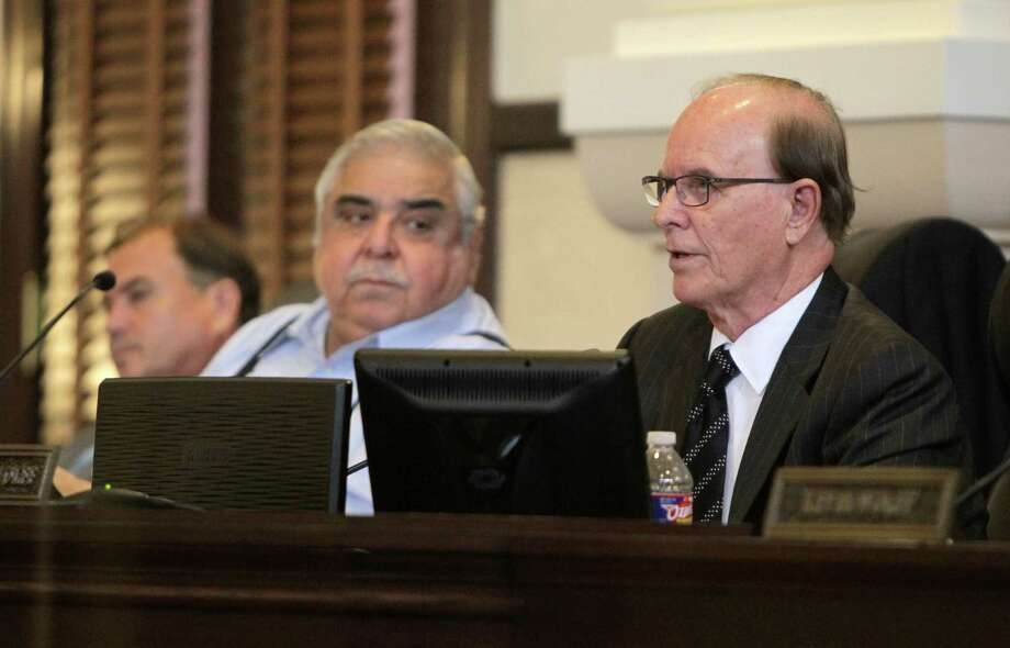 "Amid a still-under-investigation fatal shooting by two Bexar County Sheriff's Deputies, the Bexar County Commissioners' Court, led by County Judge Nelson Wolff, right, approved the new budget Tuesday Sept. 1, 2015, that includes, among other things, money to purchase body cameras for the sheriff's department and raises for the majority of county employees. Commissioner Paul Elizondo is at center and commissioner ""Chico"" Rodriguez is at left. Photo: William Luther, Staff / San Antonio Express-News / © 2015 San Antonio Express-News"