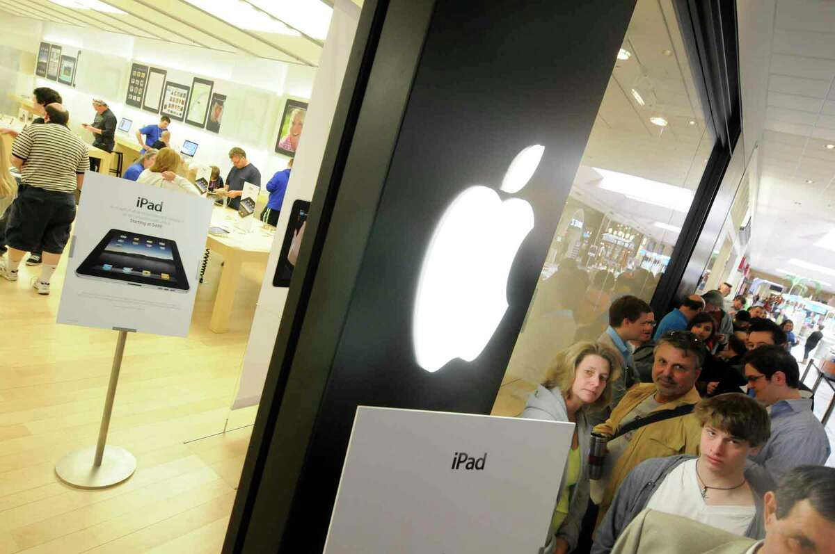 Customers wait in line at the Apple Store in Crossgates Mall April 3, 2010, in Guilderland, N.Y. (Times Union/Michael P. Farrell archive)