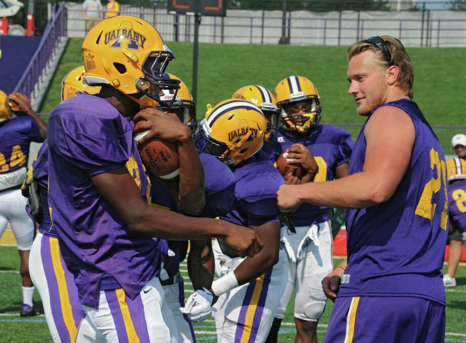 UAlbany football player Nic Ketter, right, who is injured this season, is seen working with the team during practice in Albany N.Y. (Lori Van Buren / Times Union) Photo: Lori Van Buren / 00033199A