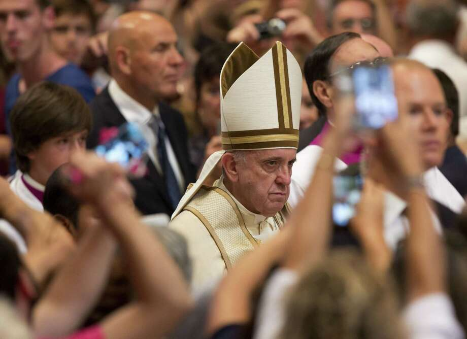 "Pope Francis arrives to attend a prayer on the occasion of the World Day of the Creation's care in St. Peter's Basilica at the Vatican, Tuesday, Sept. 1, 2015. Pope Francis declared on Tuesday he is allowing all priests in the church's upcoming Year of Mercy to absolve women of the ""sin of abortion"" if they repent with a ""contrite heart,"" saying he is acutely aware some feel they no other choice but to abort. (AP Photo/Riccardo De Luca) ORG XMIT: RDL101 Photo: Riccardo De Luca / AP"