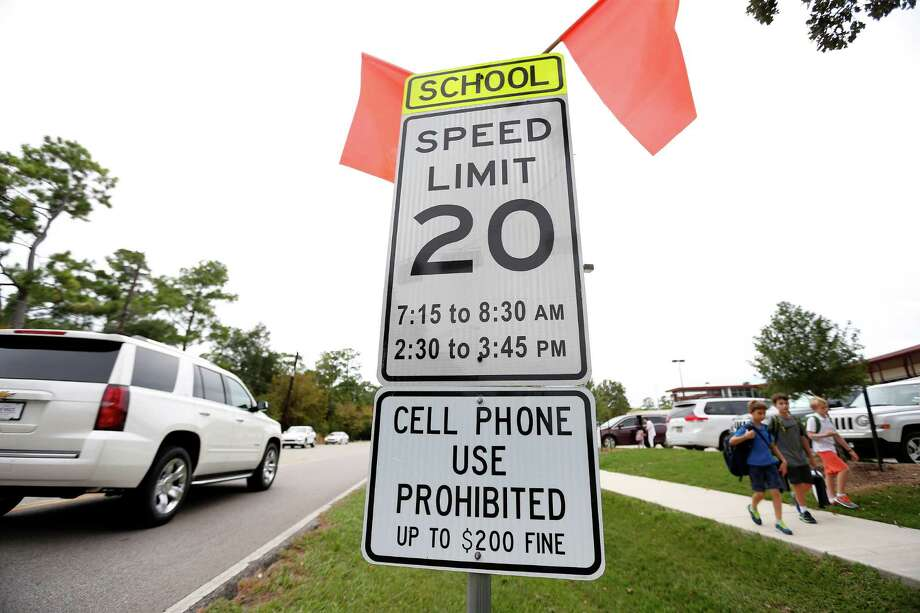 Spring Branch's Frostwood Elementary has a cell-phone sign as it's in Bunker Hill Village. The city of Houston has no such signs because of a lack of funds. Photo: Karen Warren, Staff / © 2015 Houston Chronicle