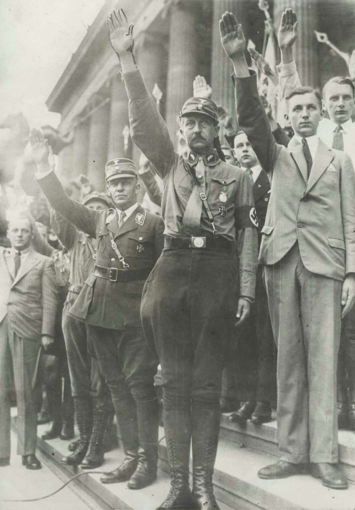 Original caption reads: Berlin, Germany: Prince August Wilhelm, son of the former Kaiser, gives the fascist salute as he reviews National Socialist drill units and students in a huge demonstration against the Versailles Peace Treaty on the anniversary of the signing of the pact. Photo was taken in 1932.