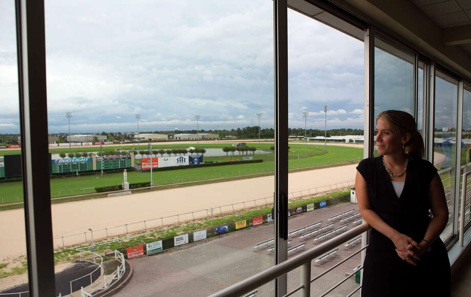 Sam Houston Race Park President Andrea Young looks out the window of a suite at the park, Tuesday, Sept. 1, 2015, in Houston. Sam Houston Race Park received notice from the Texas Racing Commission that it was ceasing operations. The letter from the Commission went on to rescind Sam Houston Race Park's ability to import simulcast wagering, live racing and exporting of live signals at midnight, August 31, 2015. Photo: Cody Duty, Houston Chronicle / © 2015 Houston Chronicle