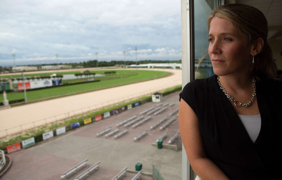 Sam Houston Race Park President Andrea Young looks out the window of a suite at the park, Tuesday, Sept. 1, 2015, in Houston. Sam Houston Race Park received notice from the Texas Racing Commission that it was ceasing operations. The letter from the Commission went on to rescind Sam Houston Race Park's ability to import simulcast wagering, live racing and exporting of live signals at midnight, August 31, 2015.