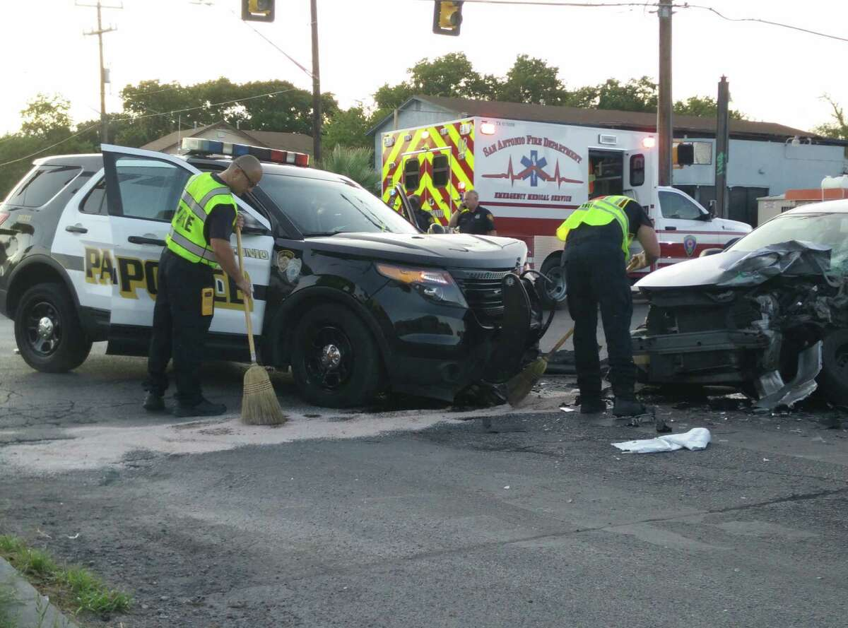 San Antonio police and EMS investigate and clear an accident in which a sedan collided with a police SUV at about 7 p.m. Tuesday, Sept. 1, at the intersection of Cincinnati and Zarzamora.