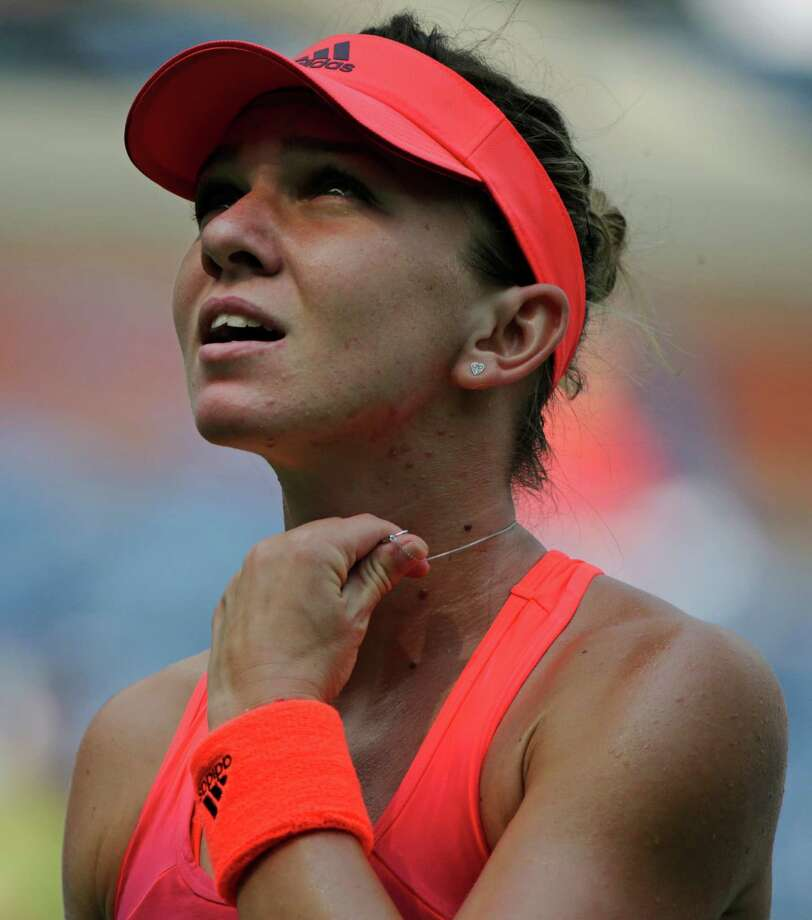 Simona Halep, of Romania, checks the scoreboard between serves against Marina Erakovic, of New Zealand, during the first round of the U.S. Open tennis tournament, Tuesday, Sept. 1, 2015, in New York. (AP Photo/Charles Krupa) ORG XMIT: USO109 Photo: Charles Krupa / AP