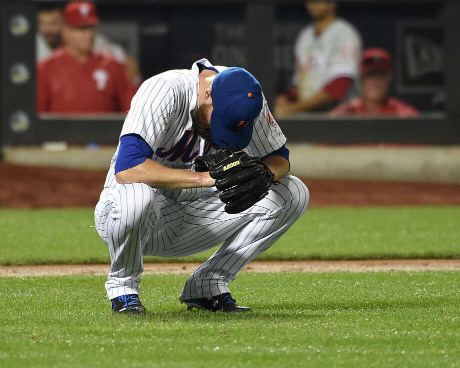 New York Mets relief pitcher Bobby Parnell reacts as Philadelphia Phillies' Andres Blanco scores on his throwing error during the sixth inning of a baseball game Tuesday, Sept. 1, 2015, in New York. (AP Photo/Kathy Kmonicek)  ORG XMIT: NYM113 Photo: Kathy Kmonicek / FR170189 AP