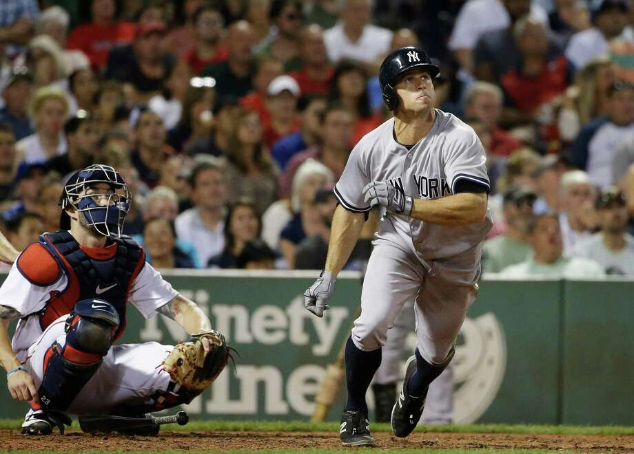 New York Yankees' Brett Gardner watches the flight of his home run as Boston Red Sox catcher Blake Swihart, left, does as well, during the eighth inning of a baseball game, Tuesday, Sept. 1, 2015, at Fenway Park, in Boston. (AP Photo/Steven Senne) ORG XMIT: MASR113 Photo: Steven Senne / AP