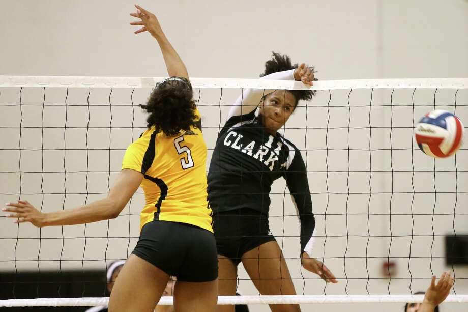 Clark's Jasmin Sneed (right) slips a shot past Brennan's Arabella Hall during their match at Clark on Tuesday, Sept.1, 2015.  Brennan won the match in three sets: 25-9, 25-23, 25-23.  MARVIN PFEIFFER/ mpfeiffer@express-news.net Photo: Marvin Pfeiffer, Staff / San Antonio Express-News / Express-News 2015