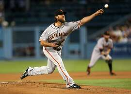 LOS ANGELES, CA - SEPTEMBER 01:  Madison Bumgarner of the San Francisco Giants throws a pitch against the Los Angeles Dodgers at Dodger Stadium Tuesday night. (Photo by Stephen Dunn/Getty Images)