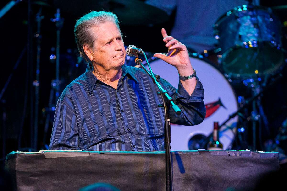 """FILE - In this March 30, 2015 file photo, Brian Wilson performs on stage during Brian Fest: A Night To Celebrate The Music Of Brian Wilson at the Fonda Theatre in Los Angeles. Wilson recently released """"No Pier Pressure."""" For his eleventh solo album, he was able to attract young recording artists like Kasey Musgraves, Nate Ruess and Zoey Deschanel and M. Ward, known as She & Him. (Photo by Paul A. Hebert/Invision/AP, File)"""