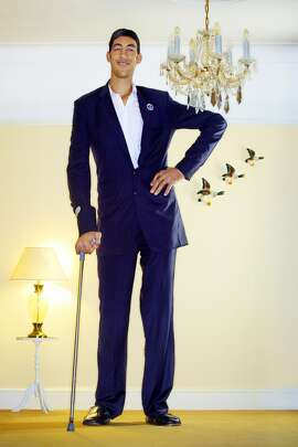 Tallest Man  Sultan Kosen (Turkey, b. December 1982) is the tallest man alive. He measured 8 feet 3 inches in February 2011.