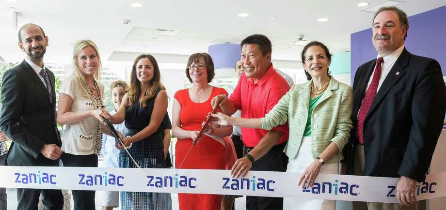 At Westport Zaniac's grand opening are, from left: Zaniac President and Chief Academic Officer Sidharth Oberoi; Zaniac Westport Co-Founder Flavia Naslausky; Zaniac Westport Co-Founder Camilla Gazal; Selectman Helen Garten; state Sen. Tony Hwang; state Rep. Gail Lavielle; and state Rep. Jonathan Steinberg. Photo: Contributed / Contributed Photo / Westport News