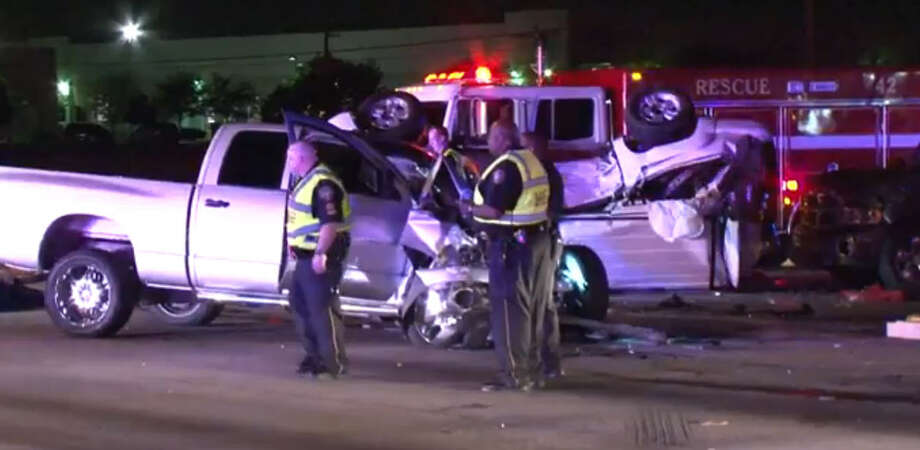 A 17-year-old boy was driving a Dodge pickup on the frontage road when he apparently ran a red light and slammed into a family inside a Chevrolet Tahoe that was headed northbound on Antoine. The Tahoe rolled over and smashed into two other vehicles that were headed southbound on Antoine. Photo: Metro Video