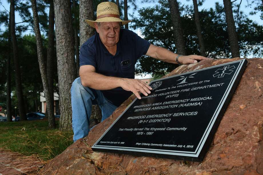 Tony Austin, Director of the Kingwood Town Center Park Association. shows off the plaque/memorial recently dedicated at the park on August 28, 2015. (Photo by Jerry Baker/Freelance) Photo: Jerry Baker, Freelance