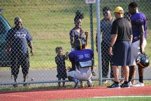 Tender moment at football practice - Photo