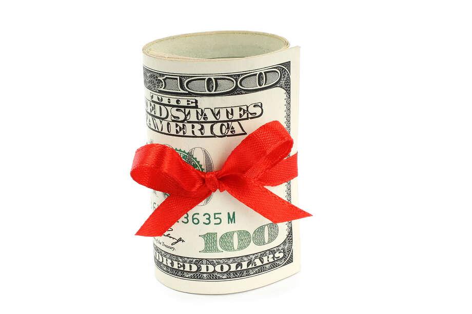 Money present on white background FOTOLIA / rvlsoft - Fotolia