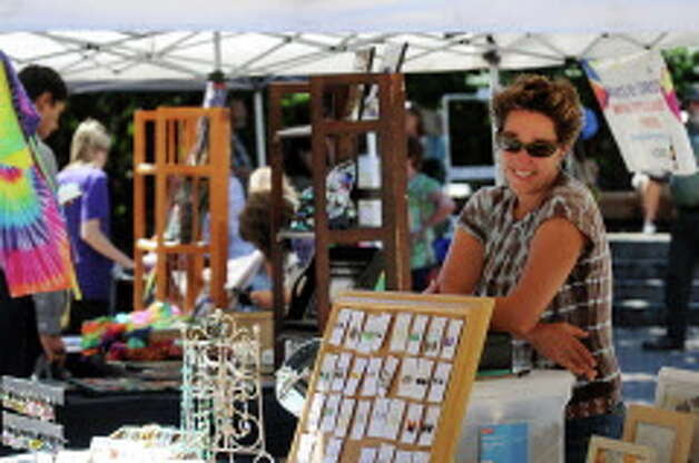 Ali Herrmann of Canaan sells her artwork and jewelry during September in the City Art Fair on Wednesday, Sept. 4, 2013, in Tricentennial Park in Albany, N.Y. The event, which occurs every Wednesday in September from 11:30 a.m. to 2:00 p.m., is sponsored by Albany Center Gallery and Exit 97.7. (Cindy Schultz / Times Union archive) Photo: Cindy Schultz / 00023685A