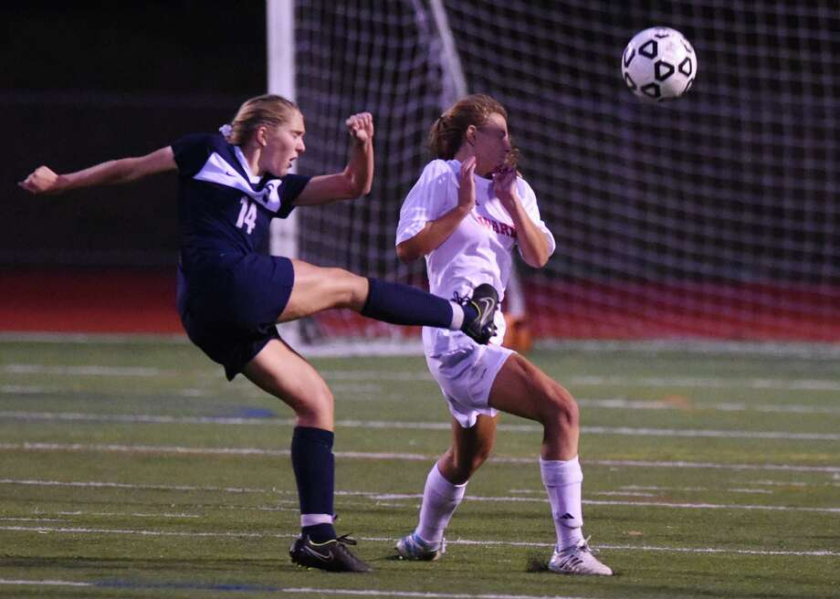 Photos from Fairfield Warde and Staples' 1-1 double overtime tie in the FCIAC high school girls soccer championship game at Norwalk High School in Norwalk, Conn. Wednesday, Oct. 29, 2014. Photo: Tyler Sizemore / Tyler Sizemore / The News-Times