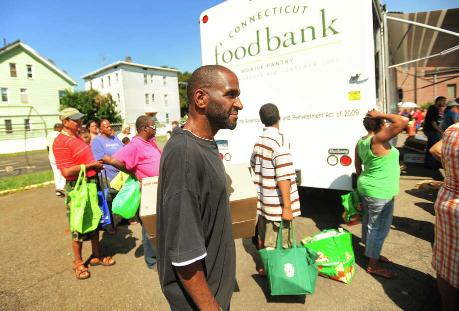 "Jesse Austin, who also calls himself ""God's poet"", of Bridgeport, waits in line at the Connecticut Food Bank's mobile food pantry at the Victory Outreach Church parking lot on Jane Street in Bridgeport, Conn. on Wednesday, August 27, 2014. The mobile pantry visits the site on the fourth Wednesday of every month at 10:30 a.m., and currently provides food to over two hundred households. Photo: Brian A. Pounds / Brian A. Pounds / Connecticut Post"