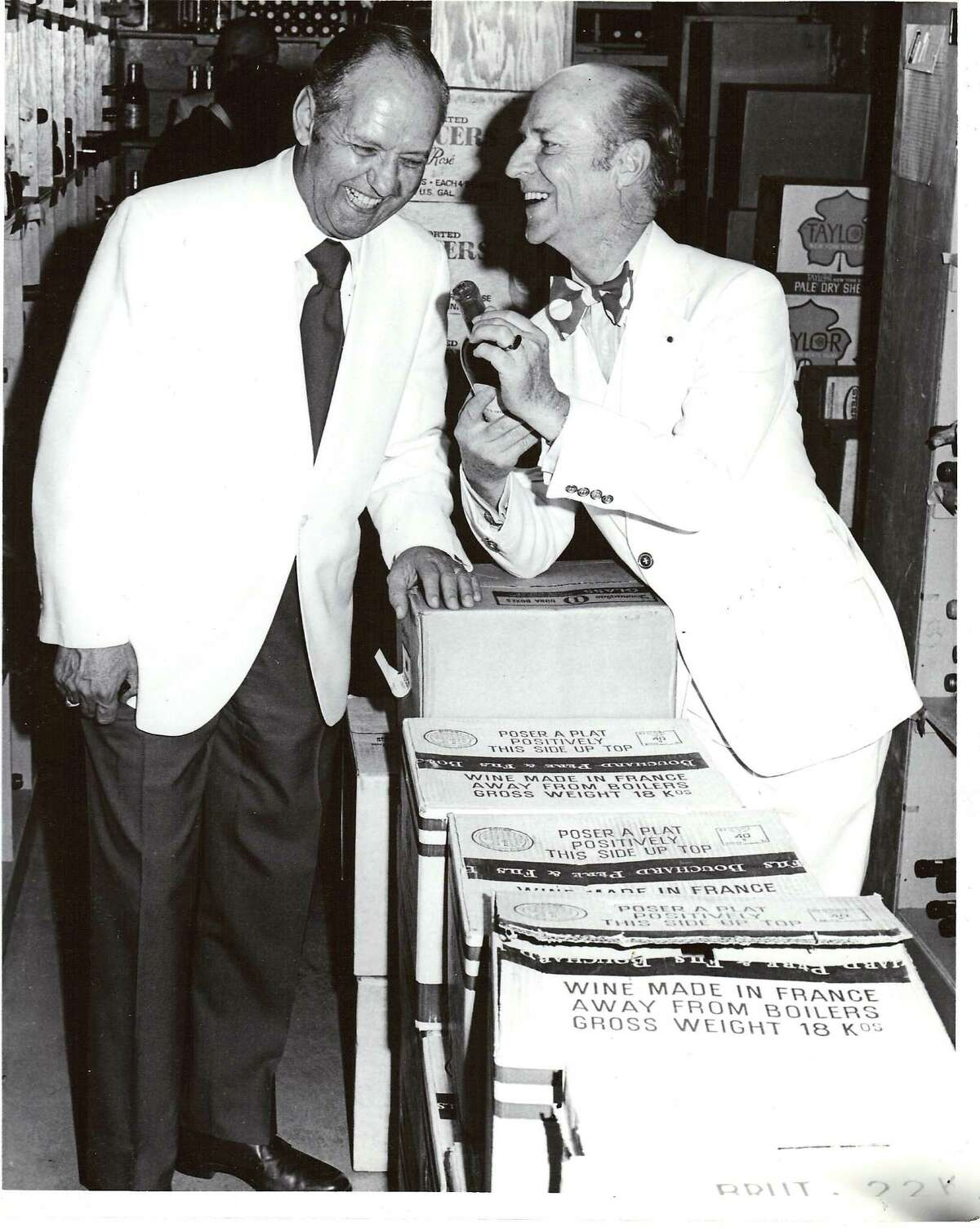 Holiday Food and Wine editor Robert Lawrence Balzar (right) meets La Louisiane owner George Dareos in the wine closet in 1974.
