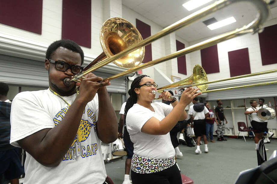 "Central High School's marching band trombonist Jamon Malbrough, 17, joins in the horn section during practice in the band room Wednesday. The group's spirited performances alongside the dance team have earned them ""Band of the Week"" honors in past seasons, a title which they hope to reclaim again this year.   Photo taken Wednesday, August 19, 2015  Kim Brent/The Enterprise Photo: Kim Brent / Beaumont Enterprise"