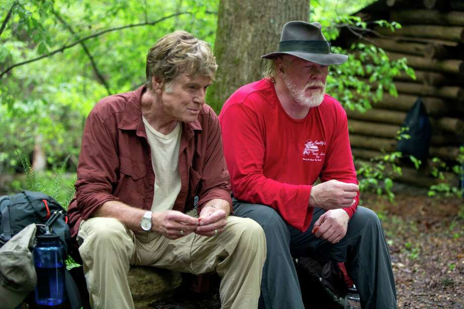 "Robert Redford, left, as Bill Bryson, and Nick Nolte, as Stephen Katz take a break while hiking the Appalachian Trail in the film ""A Walk in the Woods."" Photo: Frank Masi, SMPSP, HONS / Broad Green Pictures"