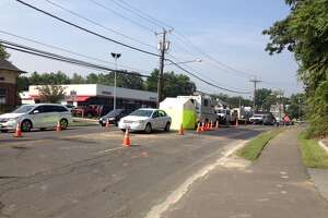 Repairs continuing on water main break in Cos Cob - Photo