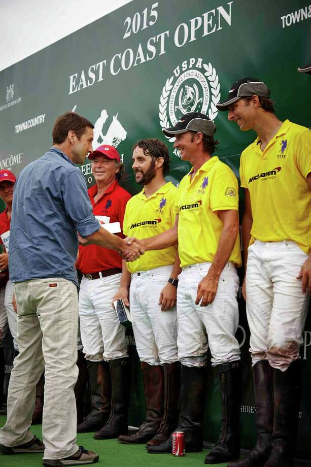 Actor Luke Wilson congratulates Nick Manifold at the Greenwich Polo East Coast Open on August 30, 2015 Photo: ChiChi Ubina/Greenwich Polo Club / Connecticut Post Contributed