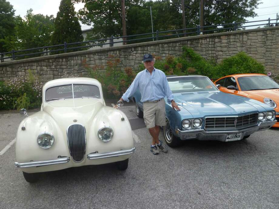 Doug Zumbach of New Canaan poses with a 1951 Jaguar XK-120 on his left and a Buick Skylark on his right.  Zumbach plans to attend the New Canaan Historical Society's House of Cars Curated Garage Tour and Gala on Saturday Sept. 12 to raise money for the 125 year old organization. Photo: Martin Cassidy / Hearst Connecticut Media / New Canaan News