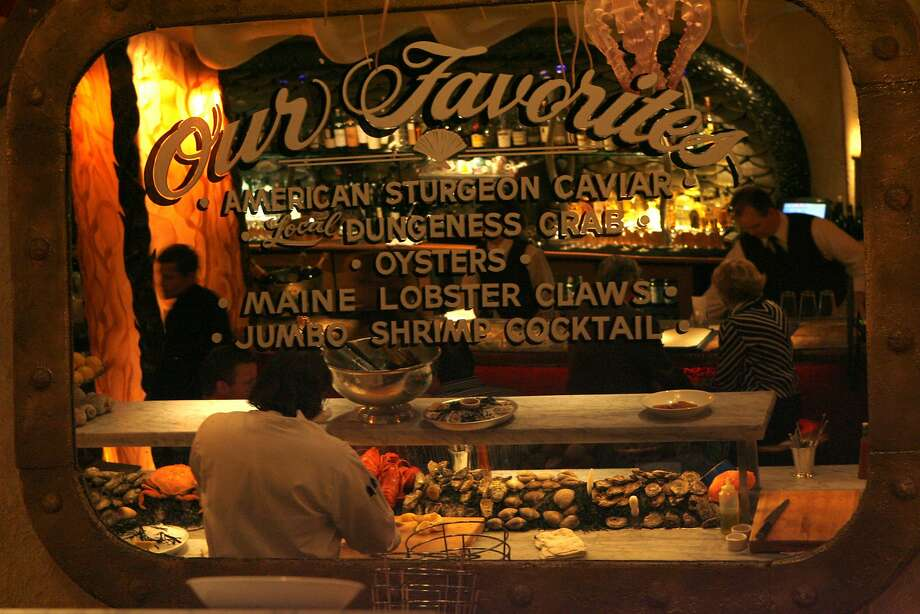 At Farallon, a mirror above the oyster bar offers customers a chance to reflect upon some top choices among the seafood offerings. Photo: Deanne Fitzmaurice, The Chronicle