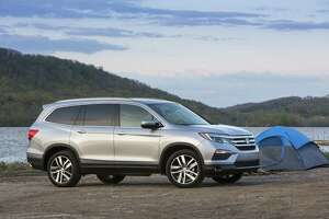 New Honda Pilot looks smaller but adds interior room, power - Photo
